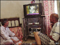 Viewers in Baghdad watching Al-Arabiya satellite TV station, 2004