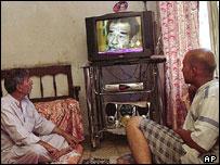 Viewers in Baghdad watching Al-Arabiya satellite TV station, 2004