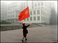 Communist Party supporter with flag, Minsk central square, 2005