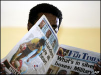 Fijian man reads newspaper
