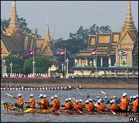 boats speed by Royal Palace, Phnom Penh, Cambodia, 2006