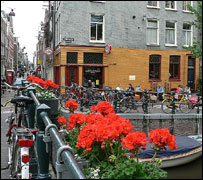 Bicycles, flowers and a canal in the Jordaan district of    Amsterdam