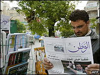 Reader scans a Syrian newspaper