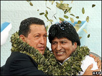 Hugo Chavez (left) and Evo Morales wearing garlands of coca   leaves, Dec 06