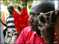 Man listens to radio during election time, February 2007, Dakar