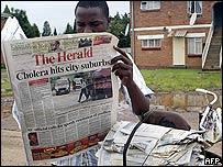 Newspaper vendor reads Harare's main daily
