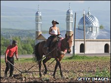 Brothers ploughing a field in Kyrgyzstan