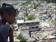 Girl surveys slum district of Port-au-Prince, April 2006